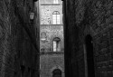 a-narrow-alley-between-two-buildings-Siena-Tuscany-Italy.jpg
